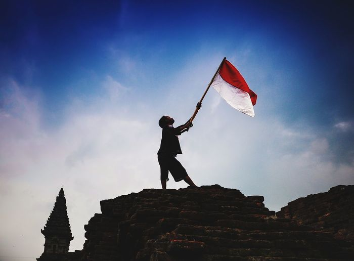 Indonesia independence day concept Flags In The Wind  Independence Day INDONESIA Child Full Length Sport Extreme Sports Flying Silhouette Athlete Males  Men Adventure Children