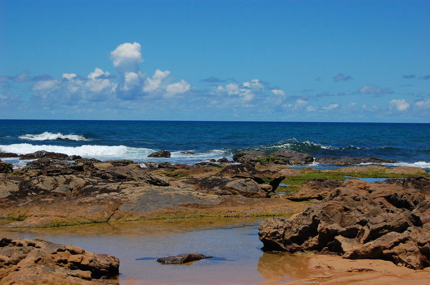 Sea Beach Rock - Object Sand Sky Horizon Over Water Water Nature Water's Edge No People Cloud - Sky Outdoors Blue Scenics Travel Destinations Day Wave Landscape Low Tide Beauty In Nature Jardim De Alah Salvador Salvador Bahia Pedras Pedra