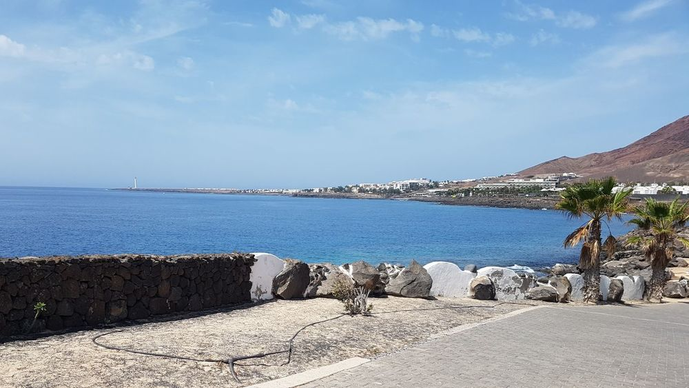Sea Beach Vacations Outdoors Sky Horizon Over Water Cloud - Sky Nature Day Travel Destinations Sand Tranquility Water Scenics Beauty In Nature Mountain People Lanzarote Lanzarote Island Playa Blanca
