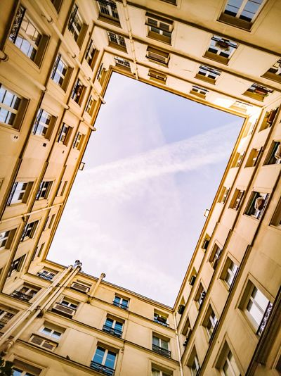 Looking up to the blue sky while standing in the middle of a courtyard. I titled my head a little, seeking the perspectives of this frame. I only see chemtrails left in the blue sky and these floors pulled on top of each others. Golden Color Tilt Facade Building Building Building Exterior Directly Below Courtyard  Escape Geometry Geometric Shape Urban Urban Geometry Architecture Architecture_collection Lookingup Looking Up Rectangle Square Shape Chemtrails Blue Sky Perspectives Perspective City Window Modern Sunlight Façade Sky Residential District Residential Structure