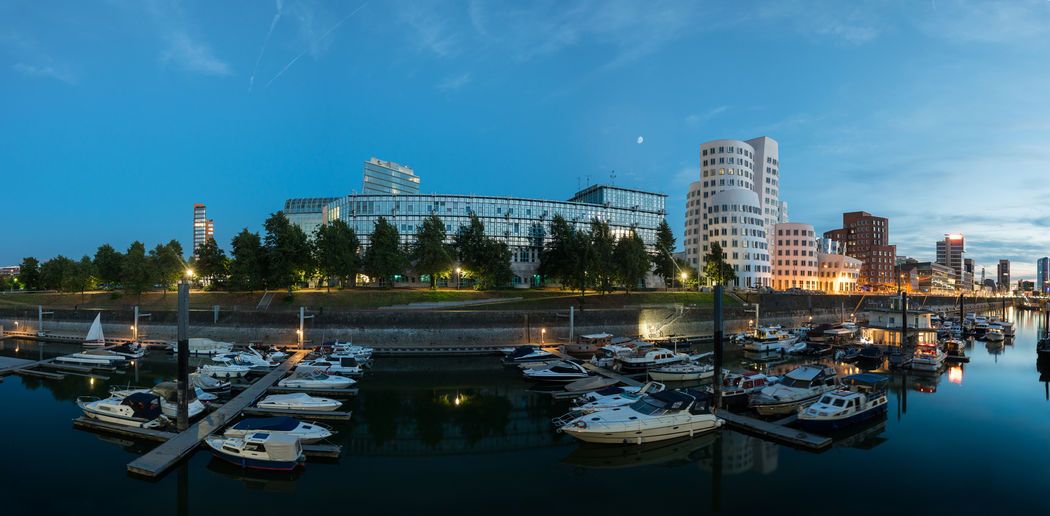 panoramic view of the media harbor in Düsseldorf germany, at the blue hour City Architecture Blue Hour City Cityscape Düsseldorf Moon Panorama Panoramic Rhine Travel cityscapes Europe Germany Landmark Media Harbor Moonlight North Rhine Westfalia Outdoors Rhine River Skyscraper Sunset Yacht Zollhaus