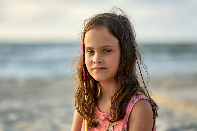 Portrait of a girl looking away at beach