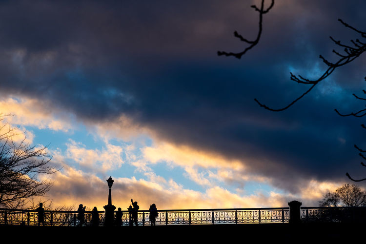 silhouette people and dried tree branch on bridge against scenic drama colour of clouds and sky at Kanazawa Castle, Japan Silhouette People Bridge Clouds Sky Drama Scenic Colour Shadow Dark Kanazawa Castle Japan Sun Sunset Blue person Travel Evening Summer Light Sunrise Purple Tree Branch Landscape Architecture Nature City Persons Promenade Beautiful Morning Woman Walk Sunny View Night Orange Crowd Red Landmark Man Romantic Happiness Lifestyle Men Romance Cloud - Sky Tranquility