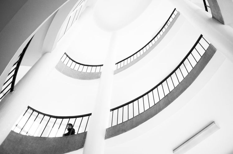 Photogenic s t a i r s. Architecture Blackandwhite Built Structure Circle CIRCLE Of LIFE Columns Day Indoors  Lonely Low Angle View Man Minimalism Modern Pillars Simplicity Single Spiral Staircase Staircase Stairs Steps Steps And Staircases Up Walking Welcome To Black White Color