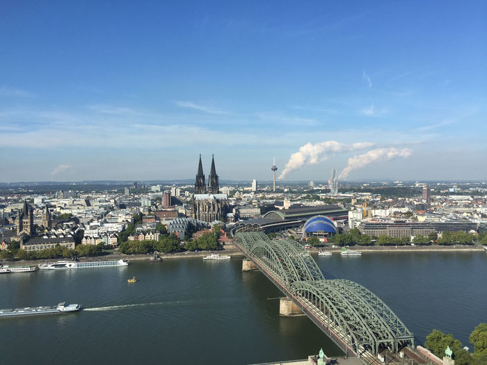 A view over Cologne / Koln Architecture Bridge - Man Made Structure Built Structure City Cityscape Cloud - Sky Connection Dom Famous Place International Landmark River Sky Water Waterfront