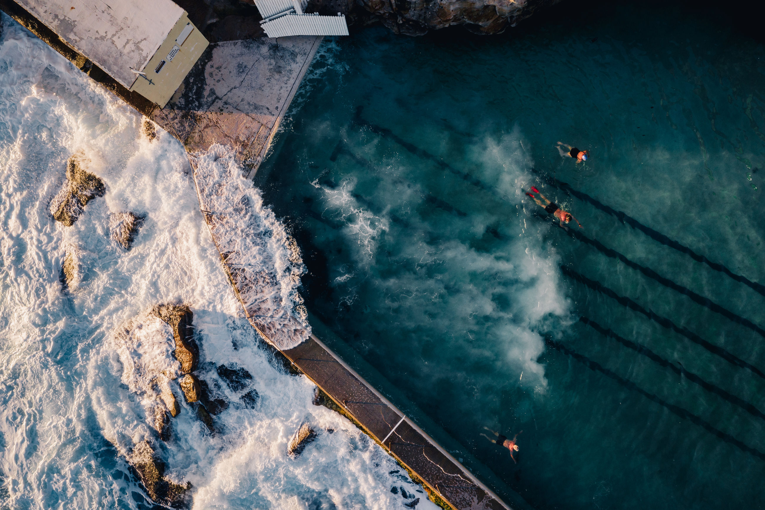 water, high angle view, nature, day, transportation, nautical vessel, sport, aerial view, travel, mode of transportation, sea, beauty in nature, outdoors, travel destinations, land, people, directly above, winter, swimming pool