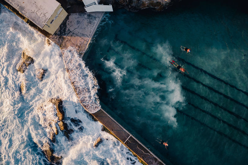 Small waves crash into Bronte Ocean Pool, Sydney. The popular pool is a favourite for photographers as it catches beautiful morning light. Have you ever been here? Week On Eyeem Aerial View Drone  Sydney Bronte Beach Day Mavic Pro Ocean Pool Outdoors Waves Summer Sydney, Australia Swimming Swimming Pool Swimmer Drone Photography Beauty In Nature Environment Sea Directly Above Travel Destinations Water High Angle View Travel Nature