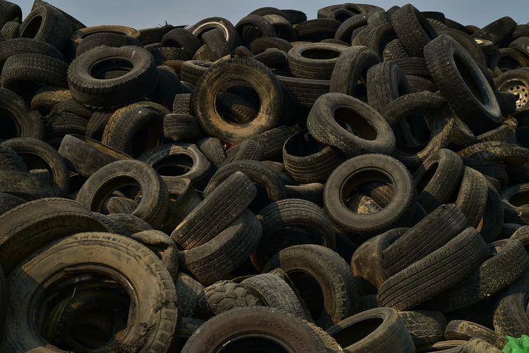 Full frame shot of abandoned tires at junkyard
