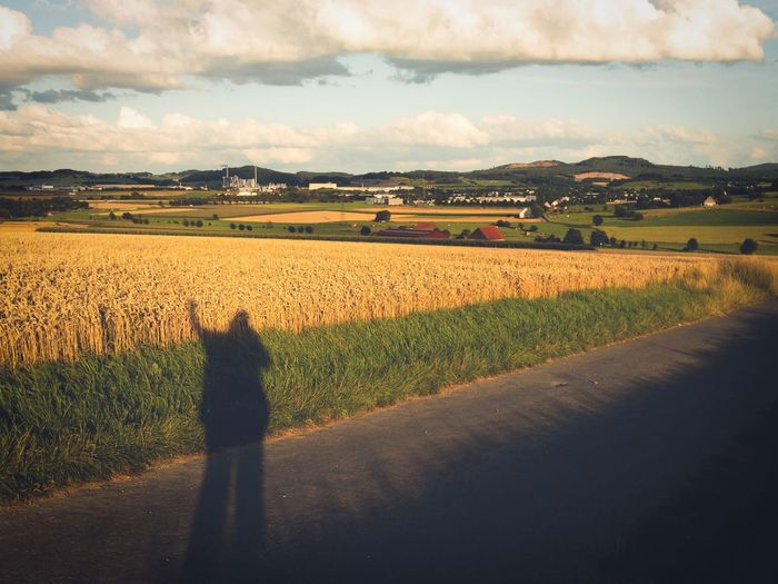 Shadows of a woman waving from a landscape in summer Agriculture Field Landscape Farm Nature Cloud - Sky One Person Countryside Person Farm Silouette Person Shadow Wavimg Woman Corn Field Brilon Sauerland Evening Retro Design Vintage Design Greeting Sun Summer Lost In The Landscape