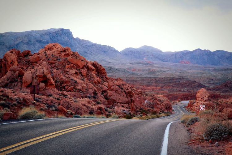 Valley of Fire at Winter Grand Canyon USA Arizona Volcano Red Fire Valley Of Fire Valley Of Fire State Park Empty Road Drive Safely Mountain Road Beauty In Nature Sky Tranquil Scene Scenics - Nature Mountain Range Landscape Environment Rock No People Non-urban Scene Transportation Tranquility Marking Nature Day Rock - Object Road Marking Rock Formation Skate Photography: Same Tricks, New Perspectives My Best Photo