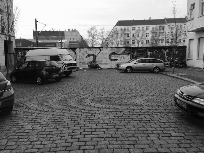 Most of Prenzlauerberg has been 'gentrified'. Many houses have been renovated and the area belongs to the most populair of Berlin. On the picture a wall (not 'The Wall') that separates the dead end street from the ring S-Bahn S41/S42. Berlin Berlijn Blackandwhite No People Outdoors Prenzlauerberg Streetphotography Urban