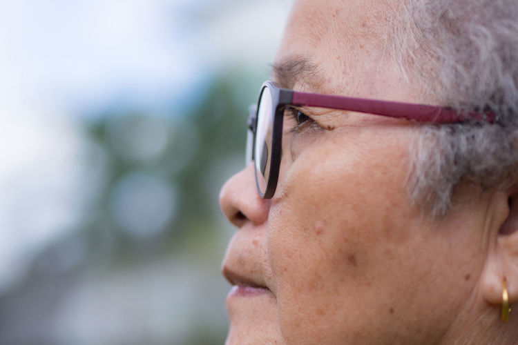 Side view of face elderly woman wearing glasses