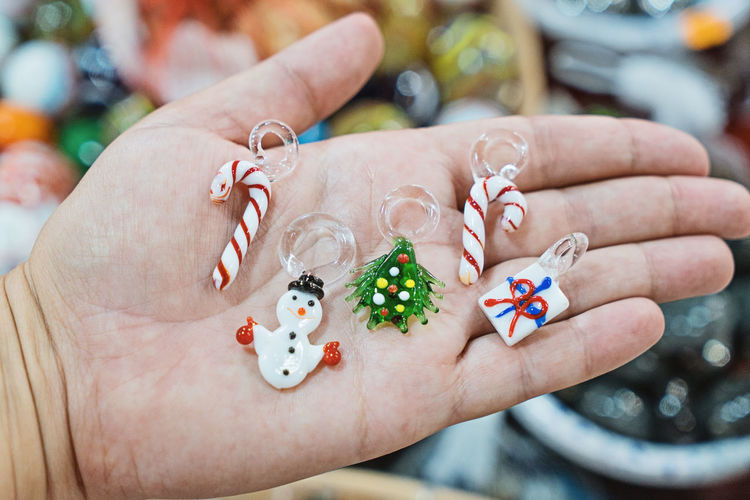 Close-up of hand holding christmas ornaments