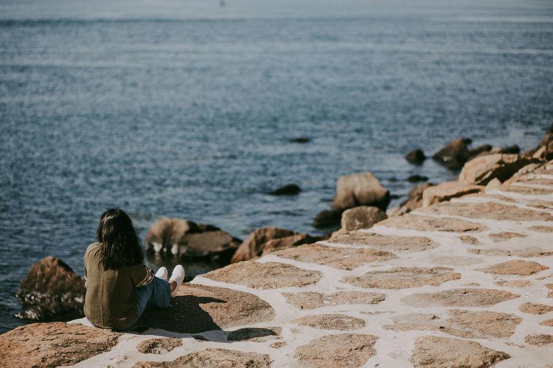 Sea Sitting Rock Leisure Activity Beach Women Lifestyles Relaxation Foz Lisbon Portugal