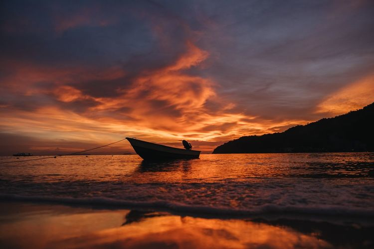 Watching the sunset on the Perhentian islands. Beauty In Nature Boat Cloud - Sky Clouds Horizon Over Water Island Malaysia Nature Nautical Vessel Ocean Orange Color Outdoors Scenics Sea Sky Sunset Tranquility Transportation Travel Water