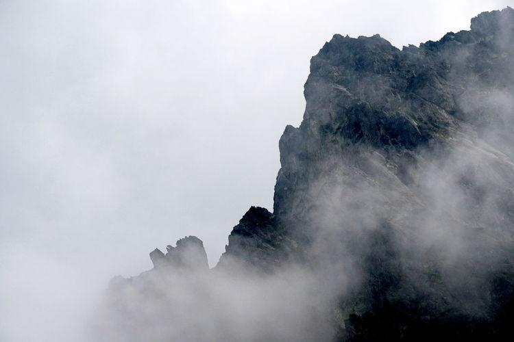 View of rock mountains amidst smoke