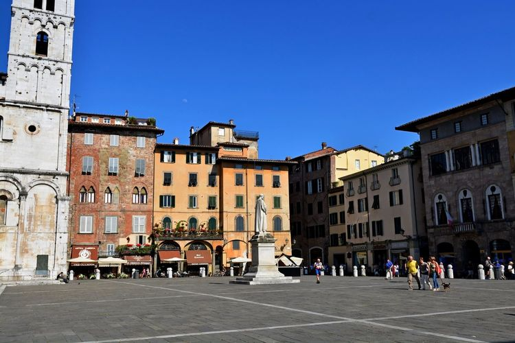 Lucca Italy Adult Architecture Blue Building Exterior Built Structure City Clear Sky Day Large Group Of People Outdoors People Sky Travel Destinations