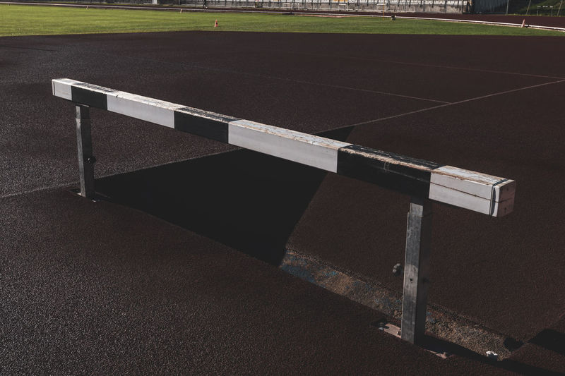 running track wooden hurdle Tartan Track Athletics Sport Running Stadium Competition Speed Lanes Hurdle Hedge Obstacles Wooden Absence Empty No People Nature High Angle View Playing Field Grass Sports Track Steeplechase