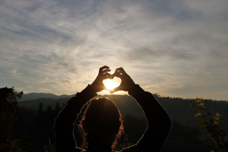 Eye4photography  Heart Human Hand Nature One Person Scenics Silhouette Sky Sommergefühle Sun Sunrise Tranquility