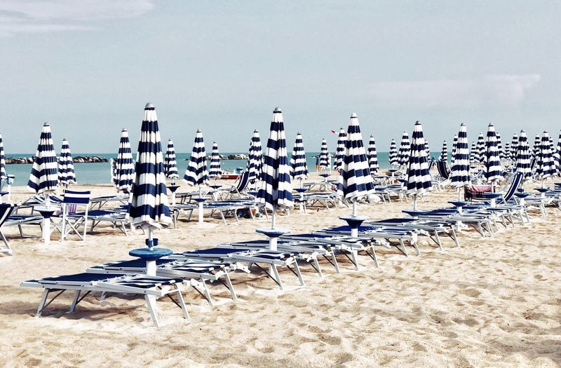 Beach Umbrella Beach Photography Beach Land Sand Sky Nature Water Chair Large Group Of Objects In A Row