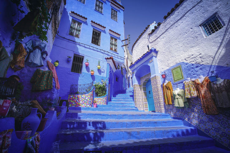"""""""The Blue City"""" - Chefchaouen Chefchaouen Medina Chefchaouen Blue City Morocco Travel Destinations Travel Travel Photography Digital Nomad Tourism Tourist Attraction  Tourist Destination EyeEmNewHere EyeEm Best Shots Built Structure Architecture Building Exterior Staircase Building Nature City Sculpture Low Angle View No People Steps And Staircases Residential District Blue Religion Belief Plant Statue Art And Craft Spirituality Place Of Worship"""