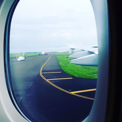 Airport Mauritius Mauritius Airport Runway Airport Ssr Airport Mauritius Plane Window Window Sky Transportation Day No People Green Color Sea