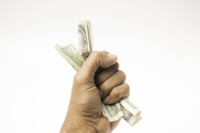 American dollars in the hand with white isolated Economics Shopping USA Bank Notes Banking Buying Close-up Copy Space Currency Dollar Notes Finance Financial Item Giving Holding Human Body Part Human Hand Money One Person Paper Currency People Savings Spending Wage Wealth White Background