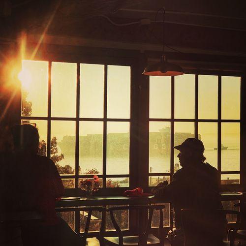 Rear view of silhouette man seen through glass window