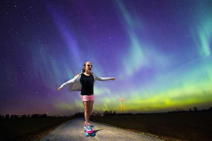 Girl skateboarding in night. Aurora Borealis is Estonia. Asphalt Aurora Aurora Borealis Dark Happy Night Lights Northern Lights Road Skateboarding Action Astronomy Full Length Galaxy Girl Kid Leisure Activity Lifestyles Nature Night One Person Outdoors People The Week On Eyem Sky Star - Space