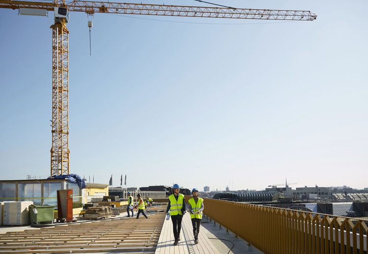 Rear view of construction site against clear sky