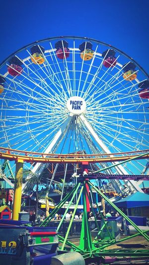 Ferris Wheel Amusement Park Arts Culture And Entertainment Amusement Park Ride Big Wheel Multi Colored Illuminated Outdoors Los Angeles, California People Pacific Park Pier Santa Monica Travel Destinations
