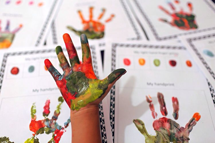 Close-up of child hand printed on paper