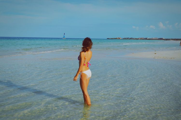 Cayo Coco Cuba Beach Sea Water One Person Vacations Childhood Holiday Child Swimwear Sky Nature Leisure Activity Day Offspring Hair Beauty In Nature Hairstyle Horizon Over Water EyeEm Nature Lover Eye4photography  EyeEm Gallery Cuba Habana Cuba2017 EyeEm Best Shots