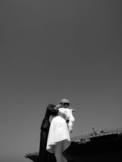Couple Standing Against Clear Sky
