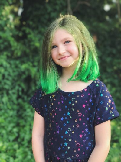 Looking At Camera Portrait Waist Up Childhood One Person Girls Green Color Green Hair Lifestyles Day Outdoors Smiling Happiness Focus On Foreground Front View Standing