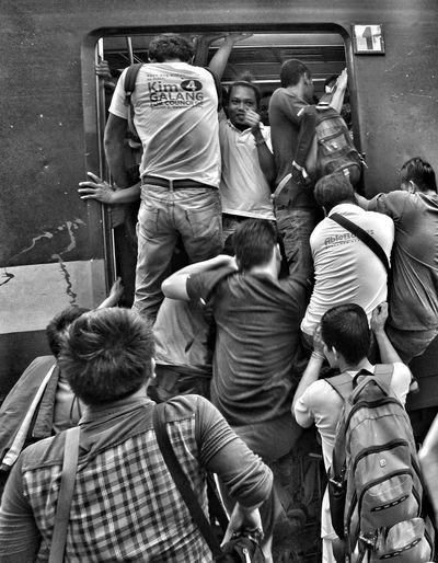 "The Photojournalist - 2017 EyeEm Awards ""Rush Hour"" PNR Manila,Philippines HardToRide PublicTrain"