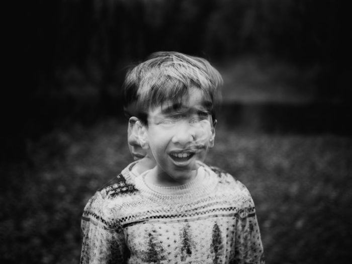 Blurred motion of boy standing outdoors