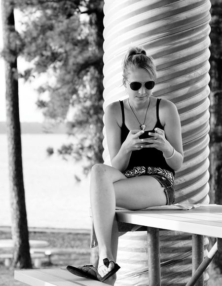 Black And White Photography Shades Of Gray Girl On Phone Girl Texting Texting Female Model Outdoor Photography EyeEm Best Shots Girl Sitting On Park Bench Ladyphotographerofthemonth
