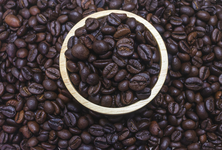 Food And Drink Coffee - Drink Coffee Roasted Coffee Bean Food Freshness Still Life Brown Large Group Of Objects Indoors  Abundance No People Coffee Bean Full Frame Backgrounds High Angle View Close-up Drink Caffeine Directly Above