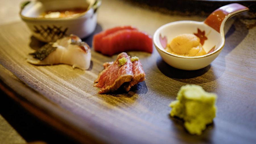 High angle view of japanese food served in wooden tray at restaurant
