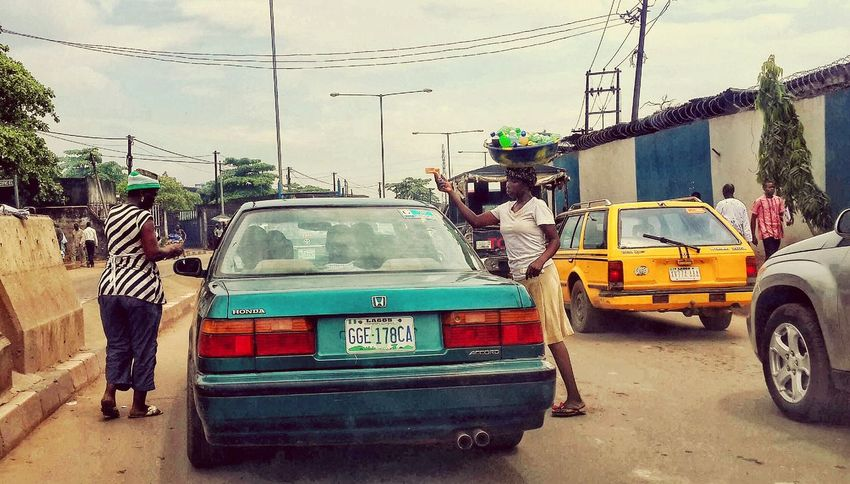 It's against the traffic law in most countries around the world to hawk goods or edibles in traffic, but when you have to survive you may be breaking the laws without paying attention The Human Condition Hawker Lagos Nigeria Hustle