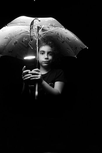 Ambrella Black Background Casual Clothing Cute Enjoyment Front View Fun Happiness Kids Leisure Activity Lifestyles Person Portrait Smiling Toothy Smile Vignette The Protraitist - 2016 Eyeem Awards The Photojournalist - 2016 EyeEm Awards The Street Photographer - 2016 EyeEm Awards Fashion Photography Showcase June