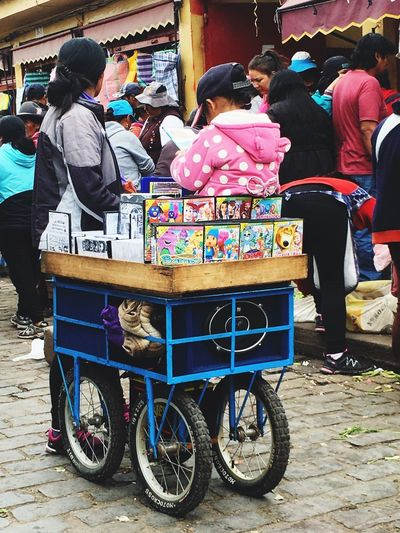A peruvian Street vendor of music and films Market Vendor Market Selling Vendor City Real People