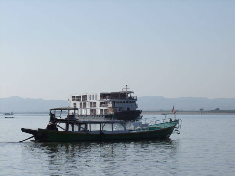 Cruise Boat on Ayeyarwady River Ayeyarwady River Blue Sky Boats Composition Cruise Boat House Boat Mandalay Mode Of Transport Mountain Range Myanmar Narrow Boat Nautical Vessel No People No People, Outdoor Photography Reflections In The Water Ripples In The Water River River Cruise Boat Sailing Tourism Tranquil Scene Transportation Travel Destination Water