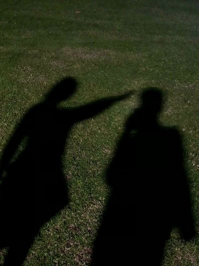 Shadow of people on grass