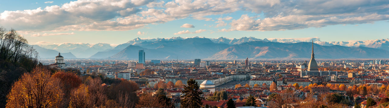 Autumn panorama of the city of turin torino piedmont, italy with the surrounding alps mountains