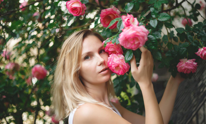 Portrait of woman with pink roses