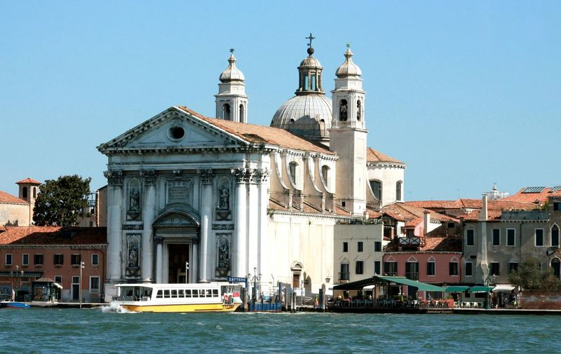 View Of Church At Waterfront