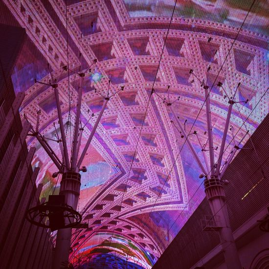 the experience and technology has certainly evolved Low Angle View Illuminated Freemont Street Experience Las Vegas Mobile Photography Taking Photos Night LEDLights Outdoors EyeEm Gallery Multi Colored Pixelated Downtown Las Vegas Entertainment Night Photography Lightshow Low Angle View Man Made Structure Technology Electronic Art