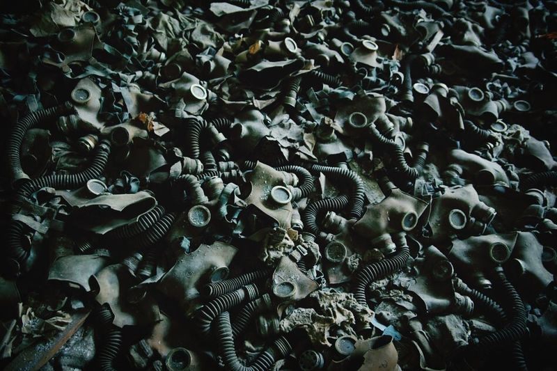 High Angle View Of Rotting Gas Masks